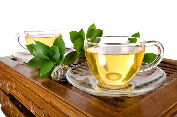 green-tea-drink-cups-leaves-table-white-background